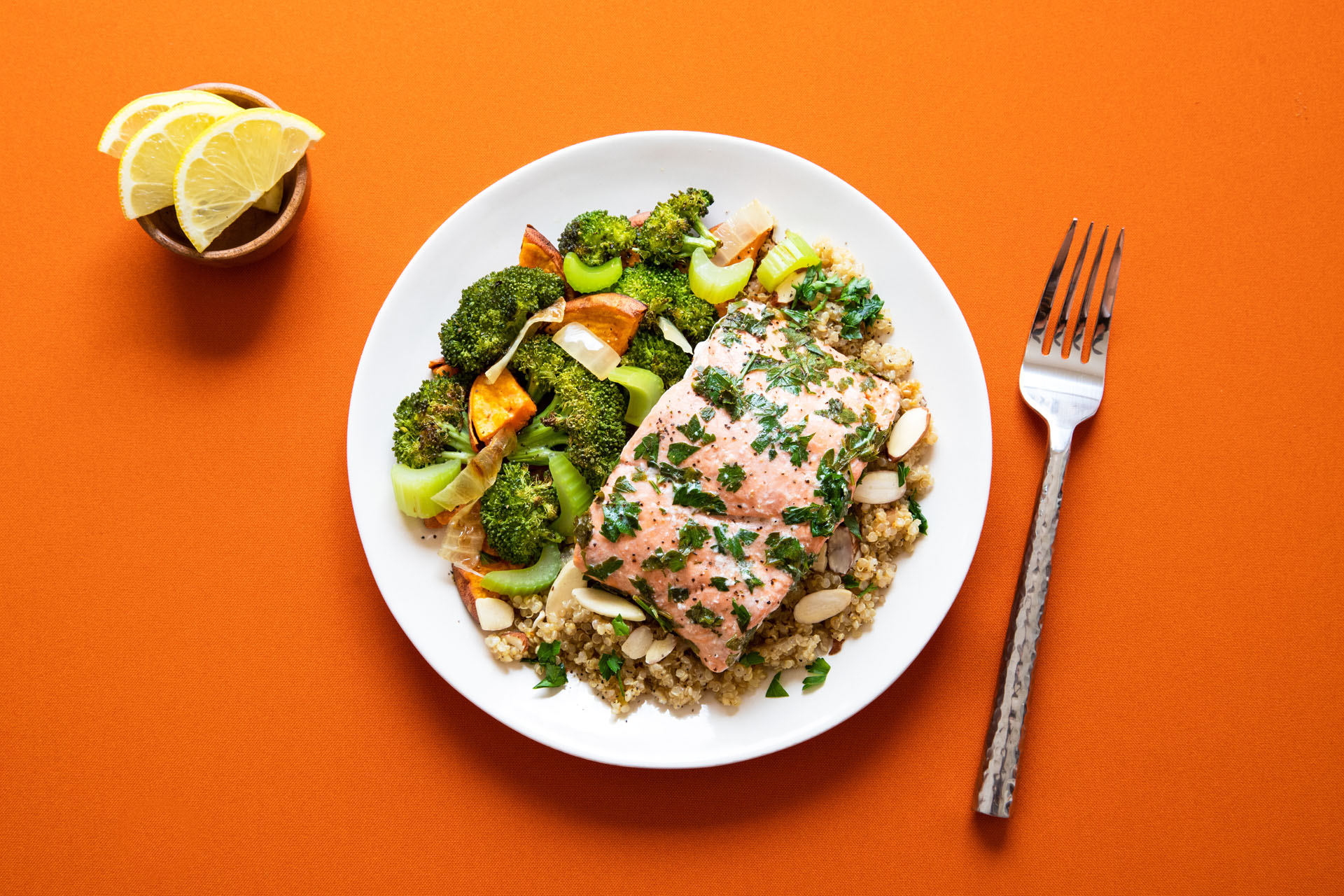 plate of salmon and greens with grains