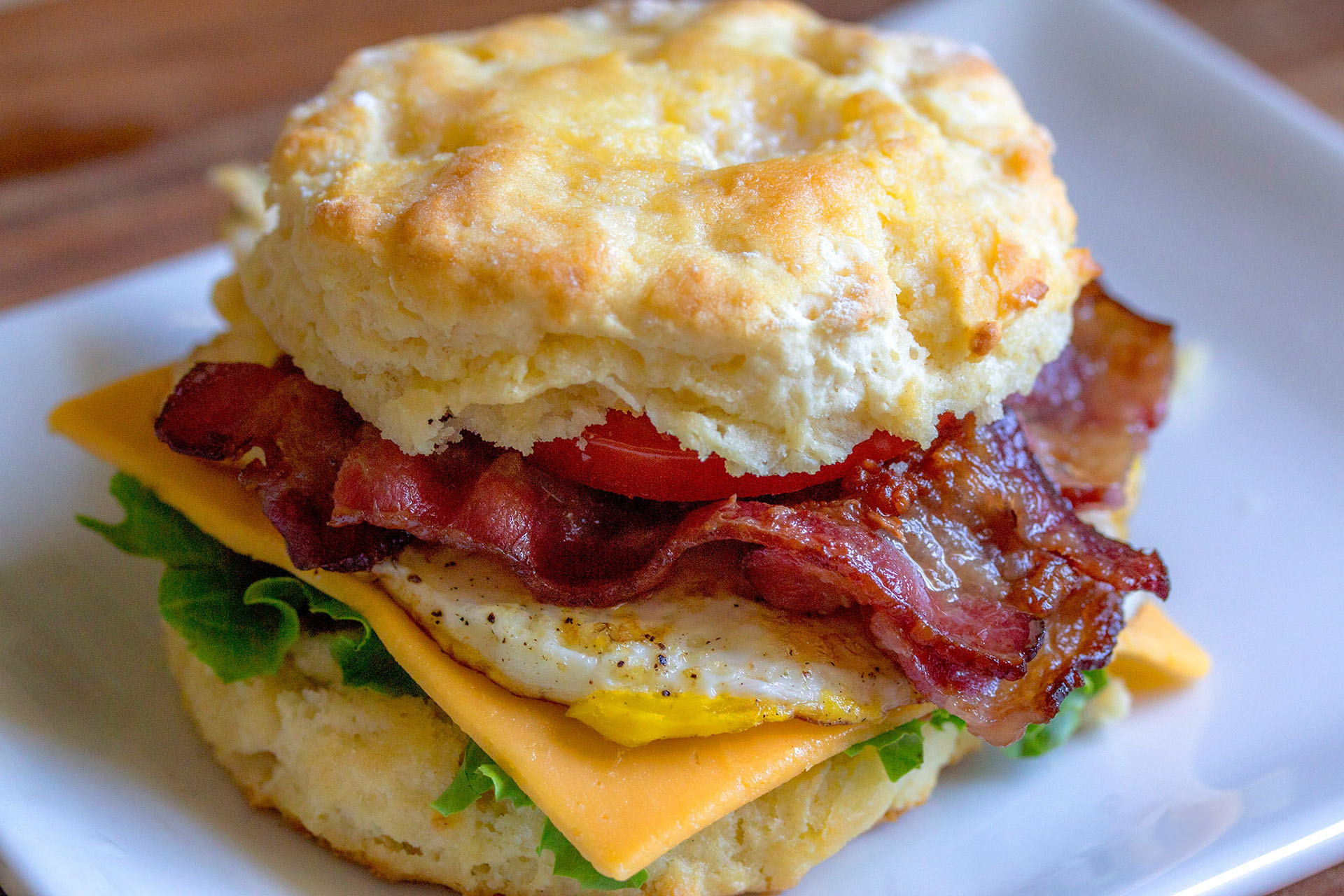 breakfast sandwich with egg, bacon and cheese
