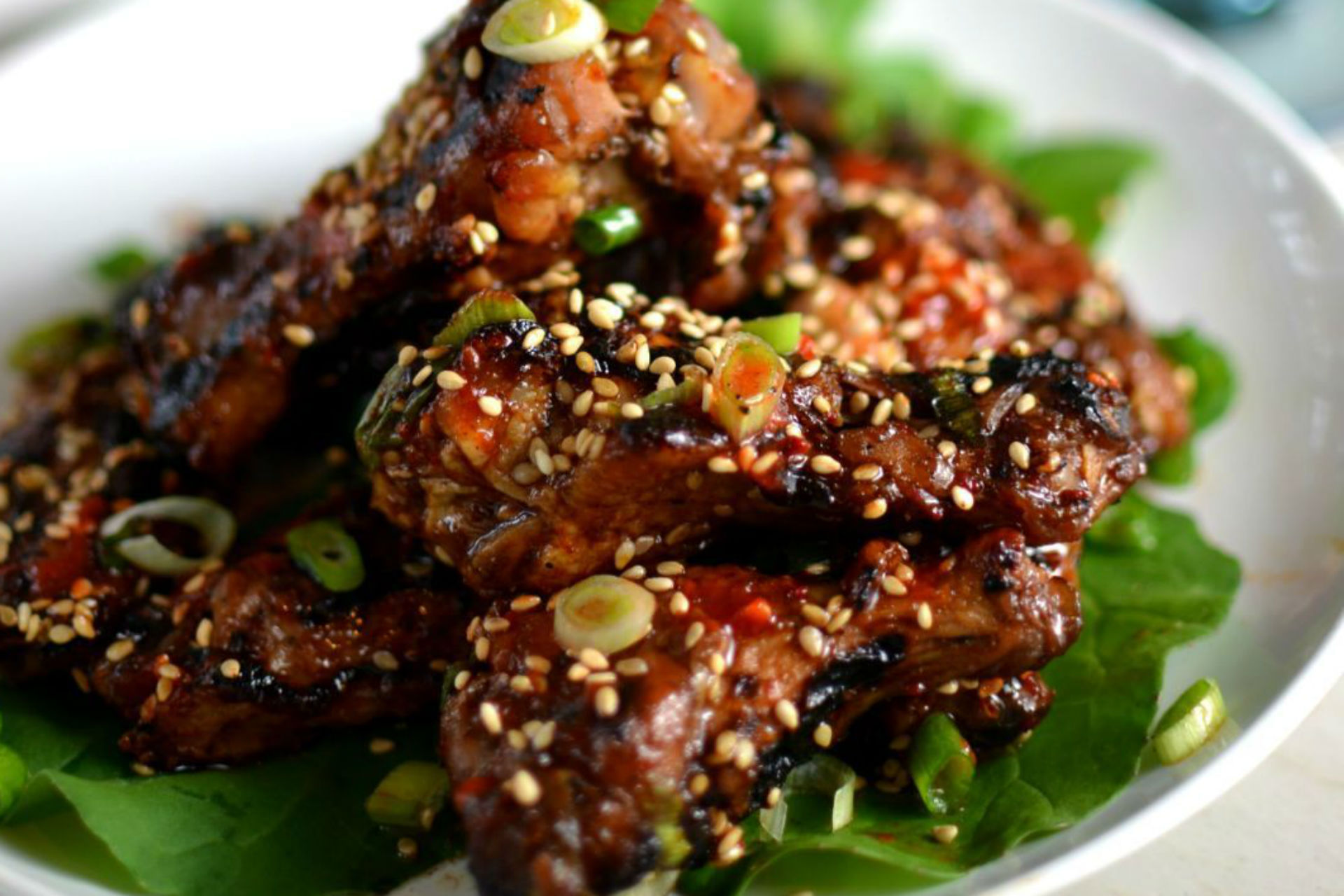 pile of chicken wings with sesame seeds