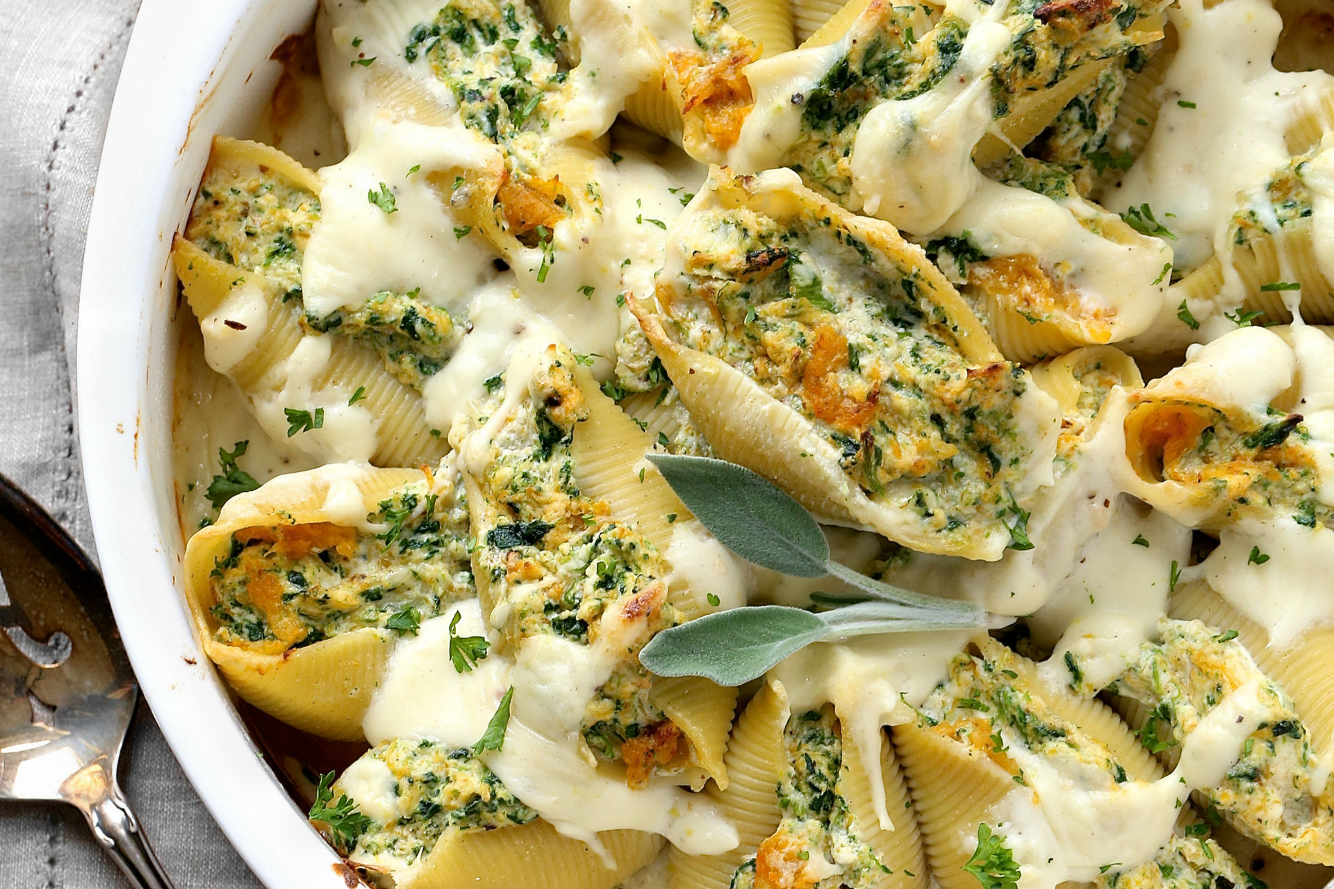 ricotta and squash stuffed shells in a casserole dish