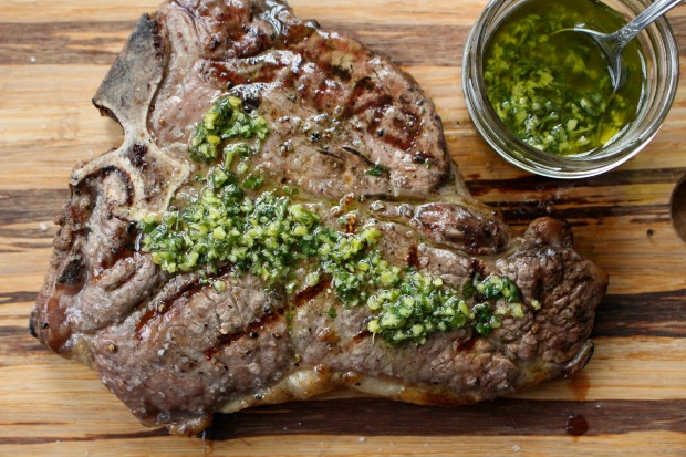grilled steak on a cutting board with marinade