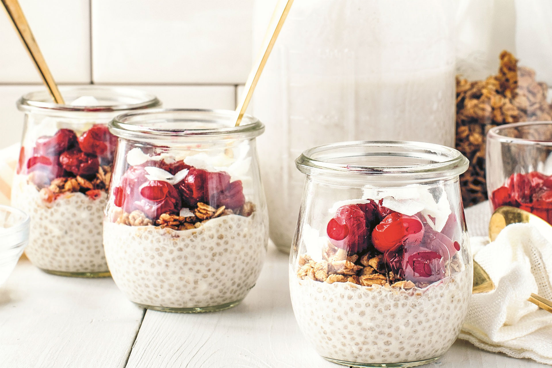 jars of parfait with cherries