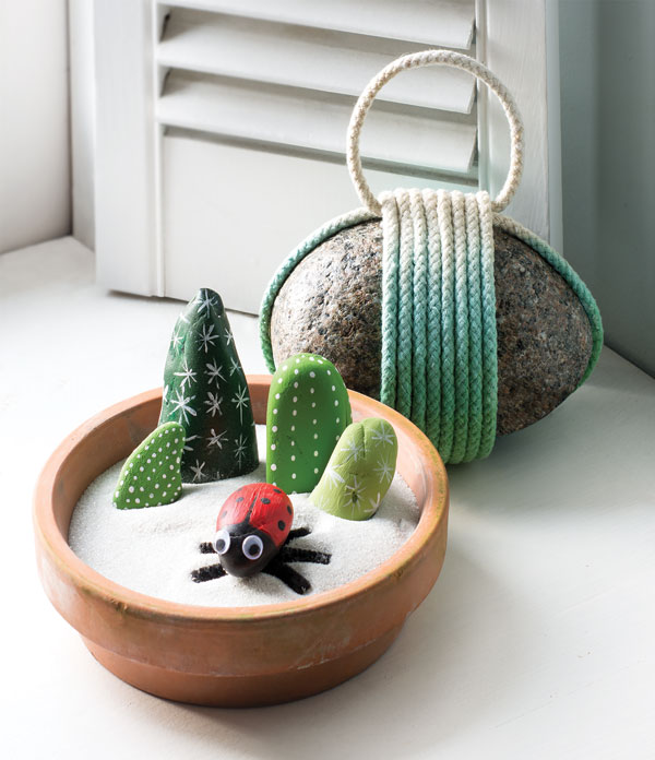 garden with stones painted like ladybugs and cacti
