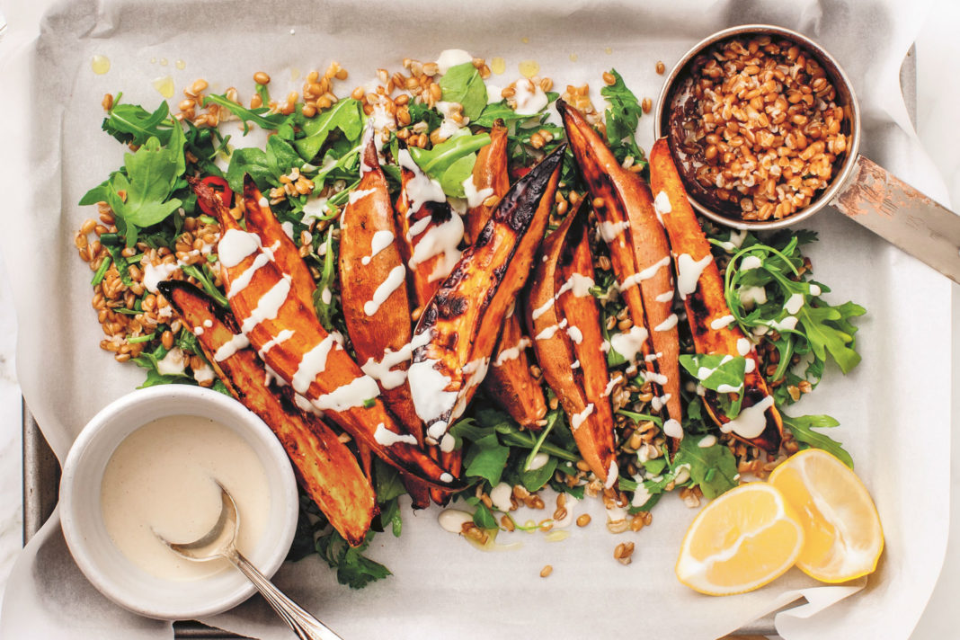 sweet potato fries on herbed grains with arugula