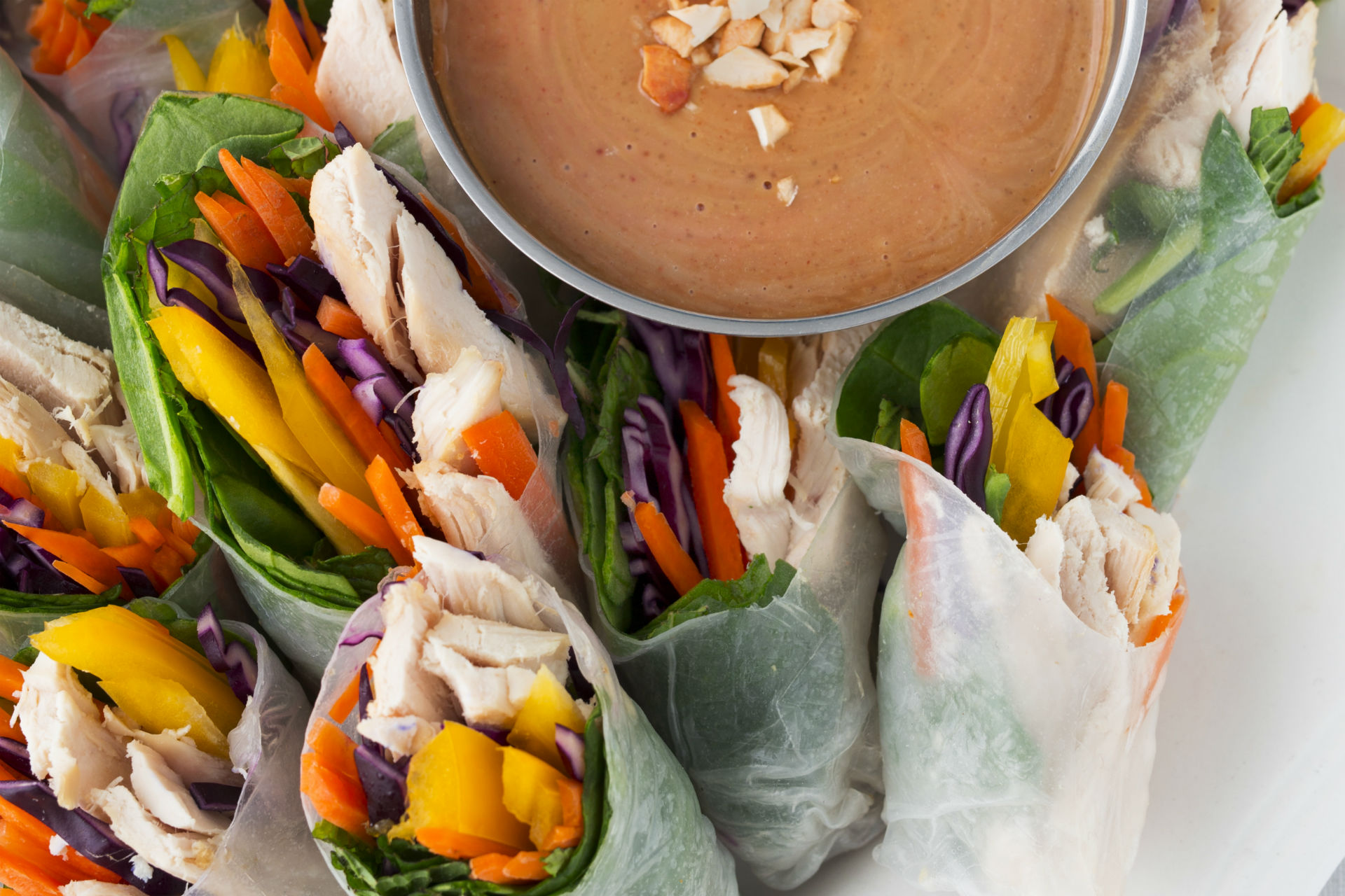 fresh rolls with chicken and veggies and a peanut dipping sauce