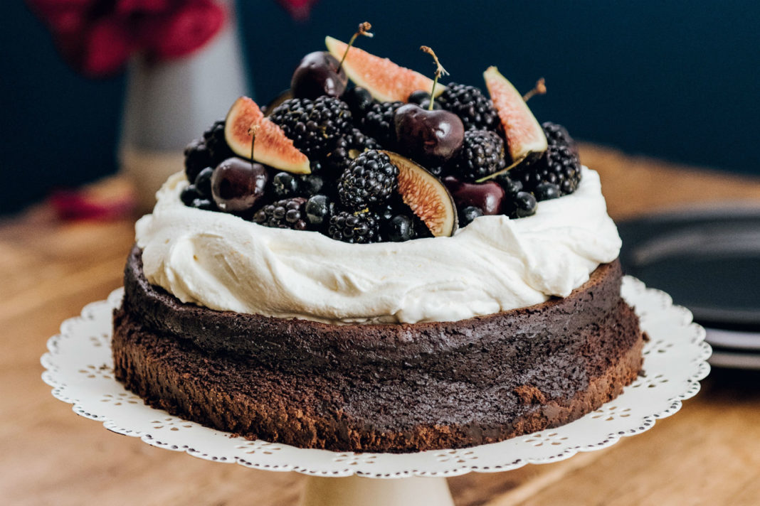 chocolate cake with whipped cream and fresh fruit
