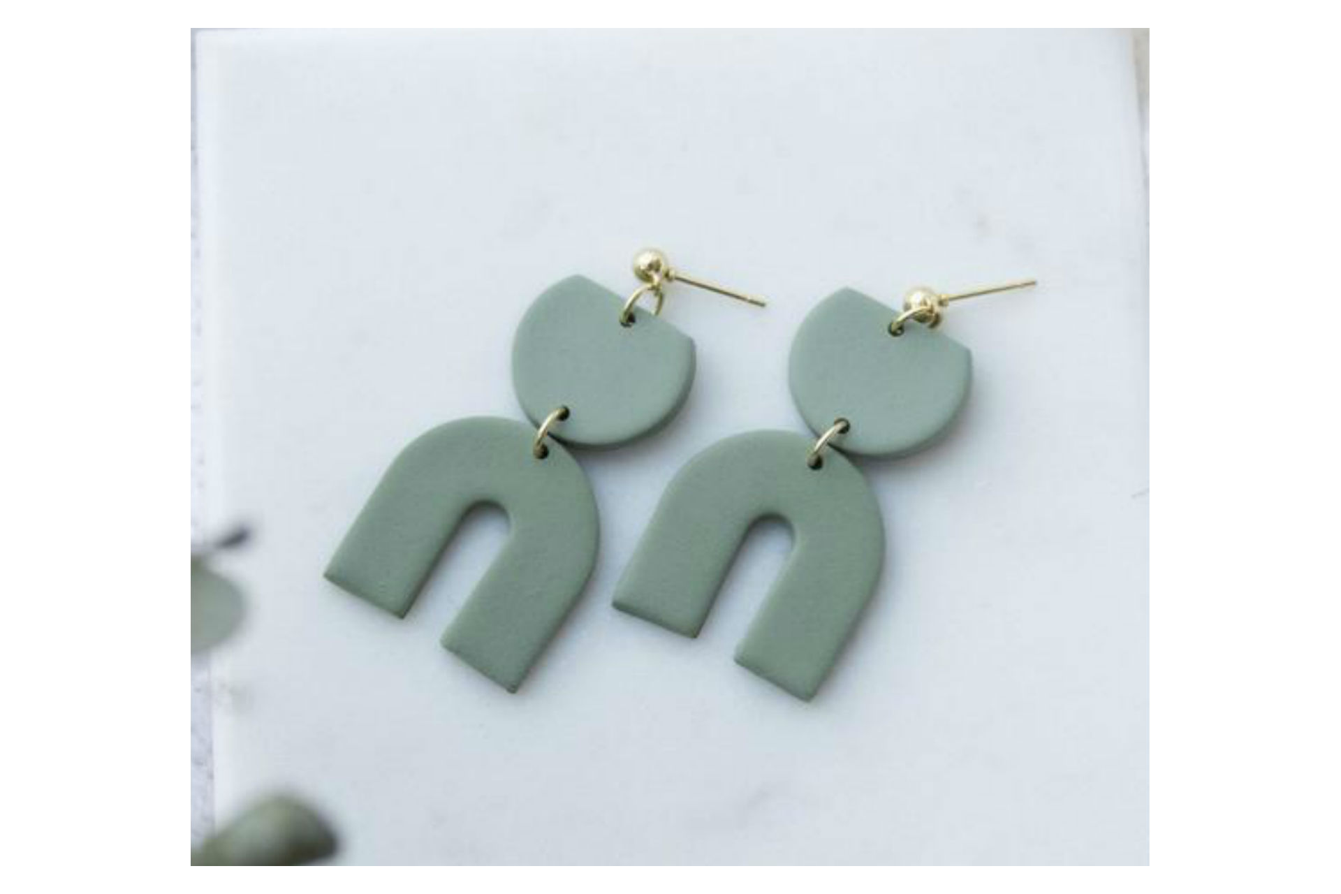 Delicate arch olive green earrings