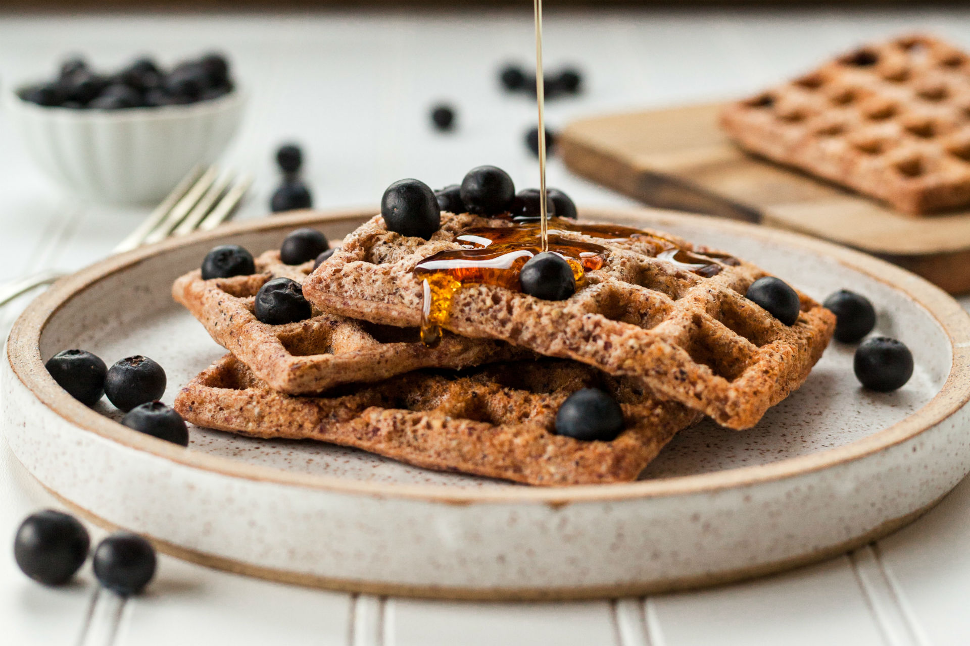 stack of waffles with berries