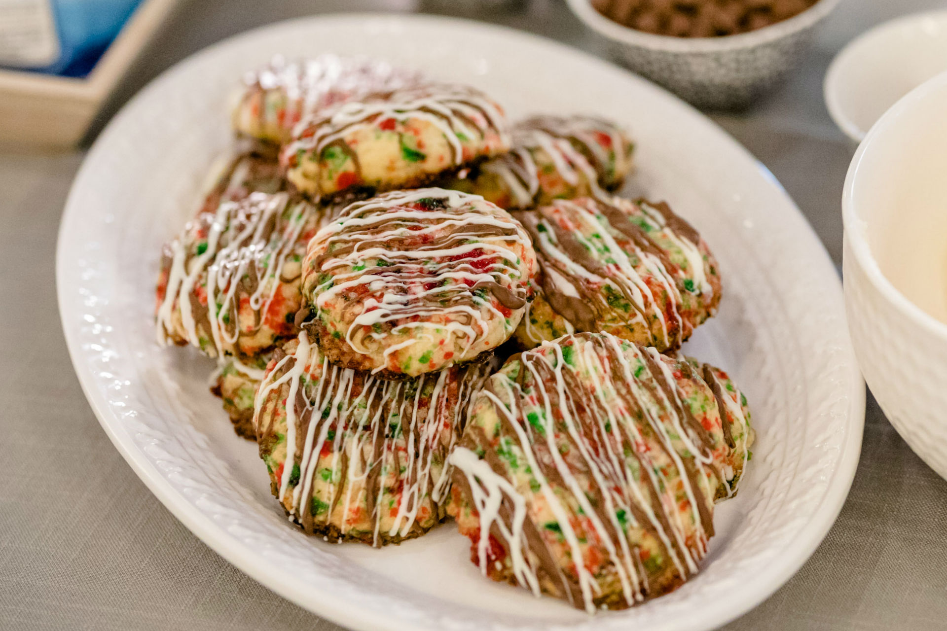 plate of cookies drizzled with chocolate