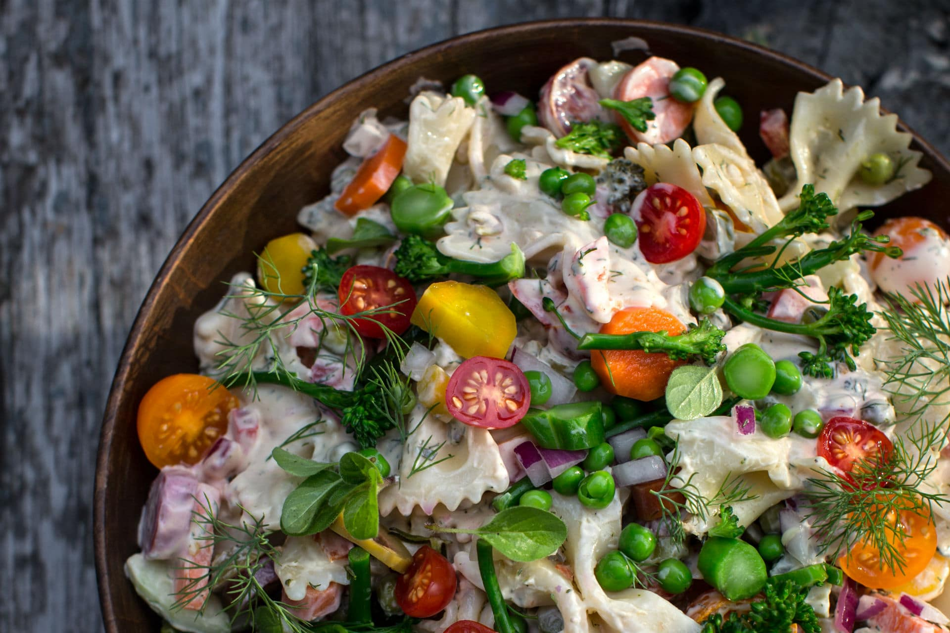 bowl of pasta salad with fresh veggies and dill