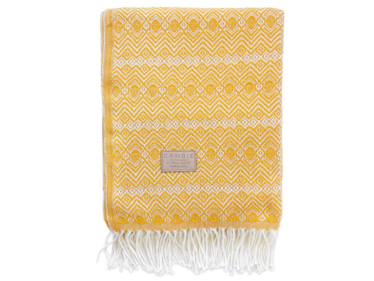 yellow and white blanket with fringe
