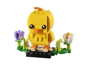 yellow Lego chick with two flowers and two eggs
