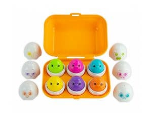 Orange egg carton with toy eggs and chicks inside