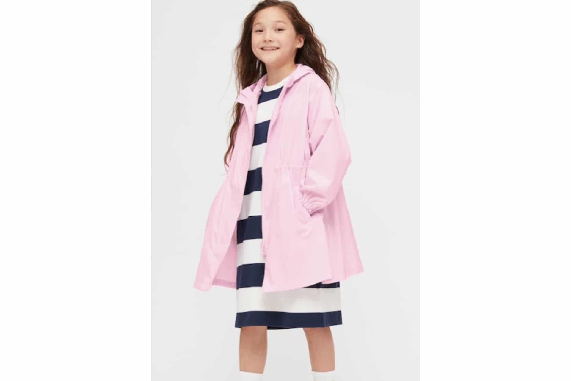 pink rain coat on a girl wearing a striped dress