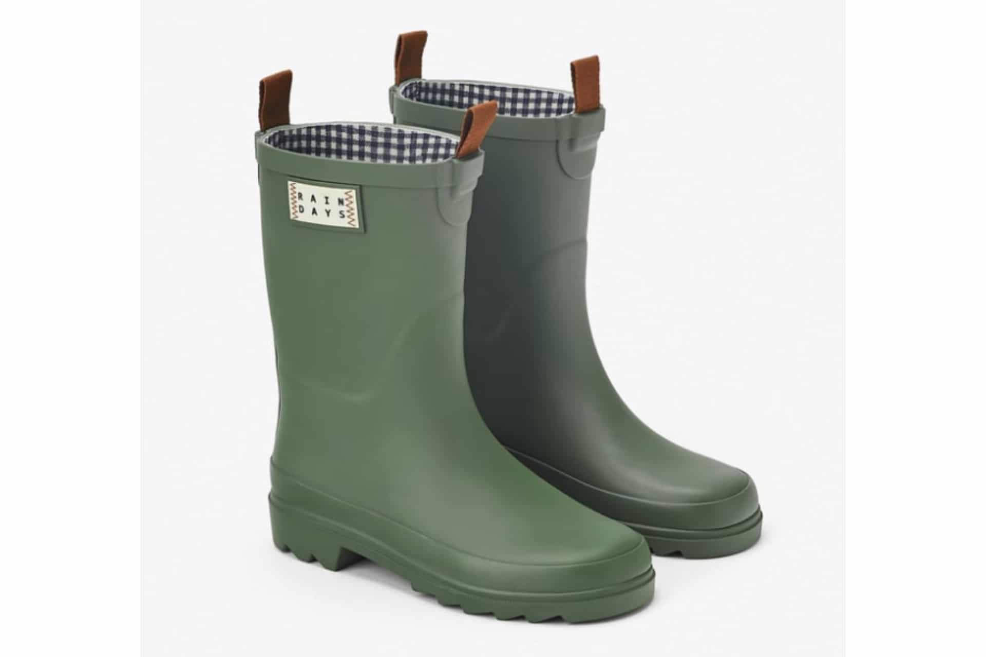 green rain boots with leather pull tab