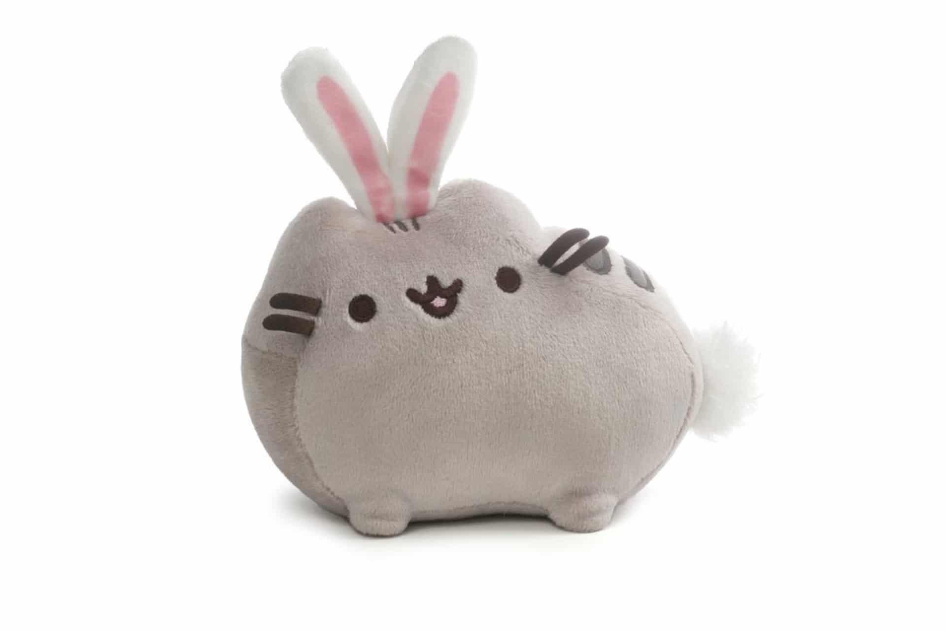 stuffed cat wearing bunny ears