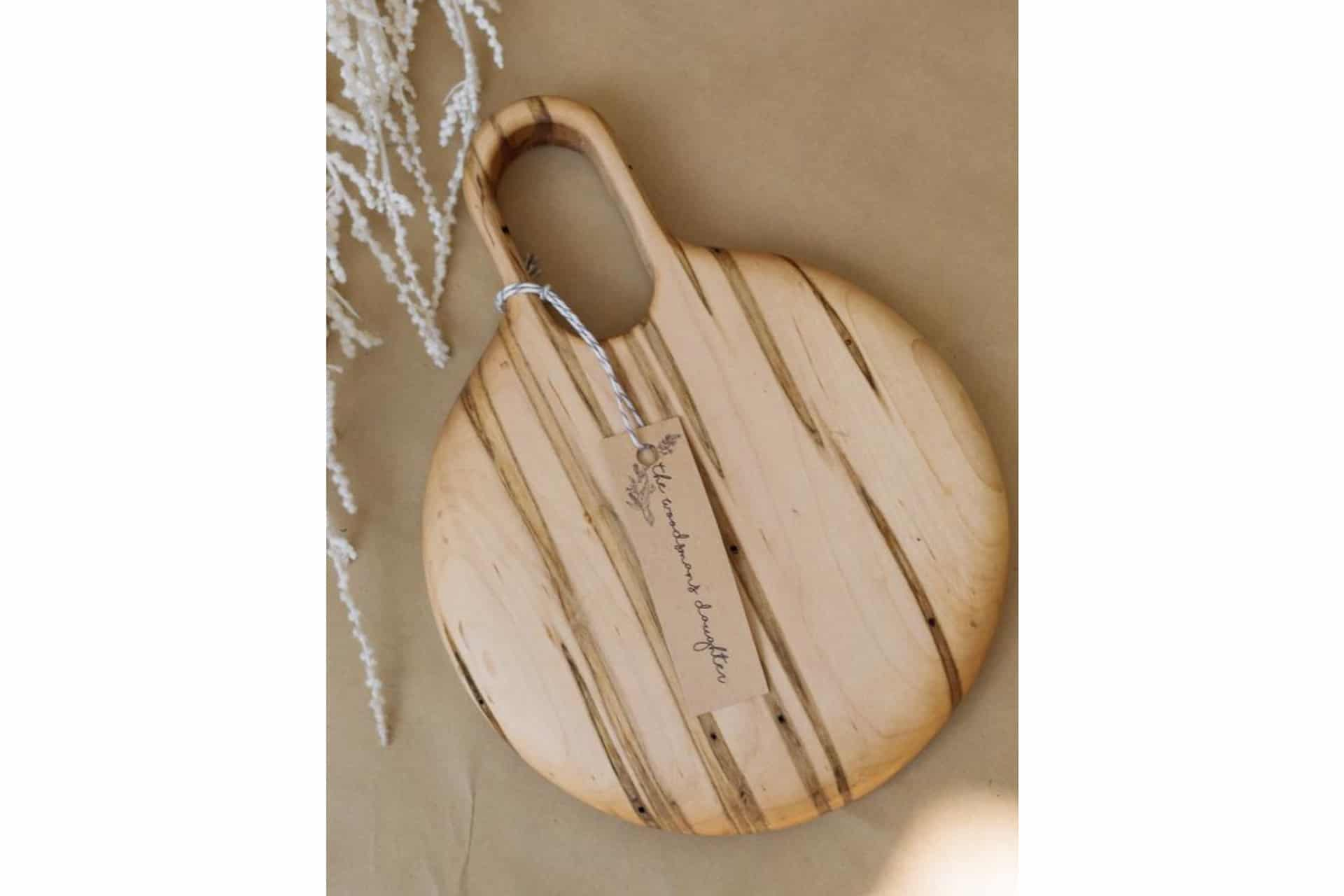 wooden cutting board with a pretty handle