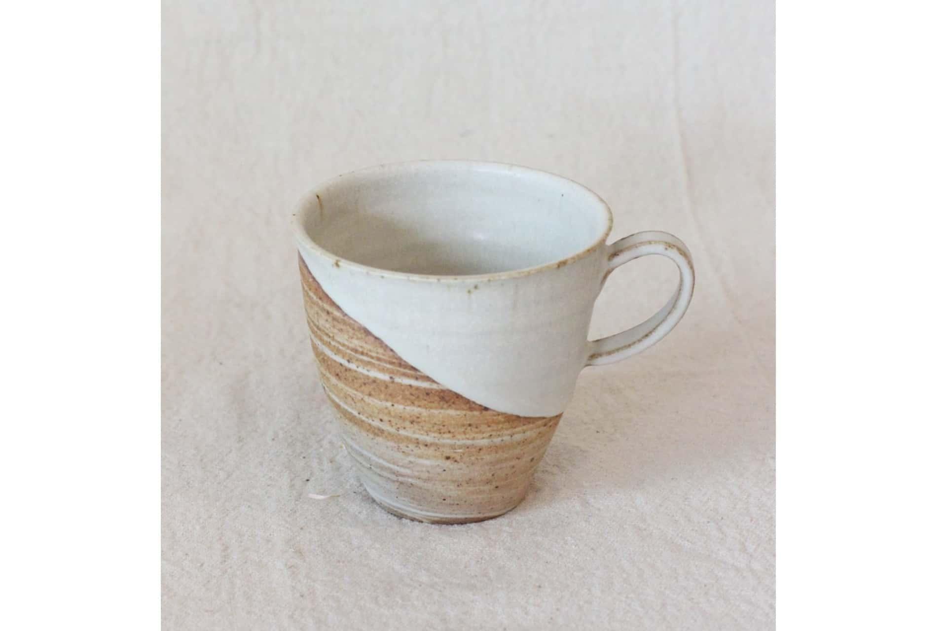 ceramic mug with half white glaze dip