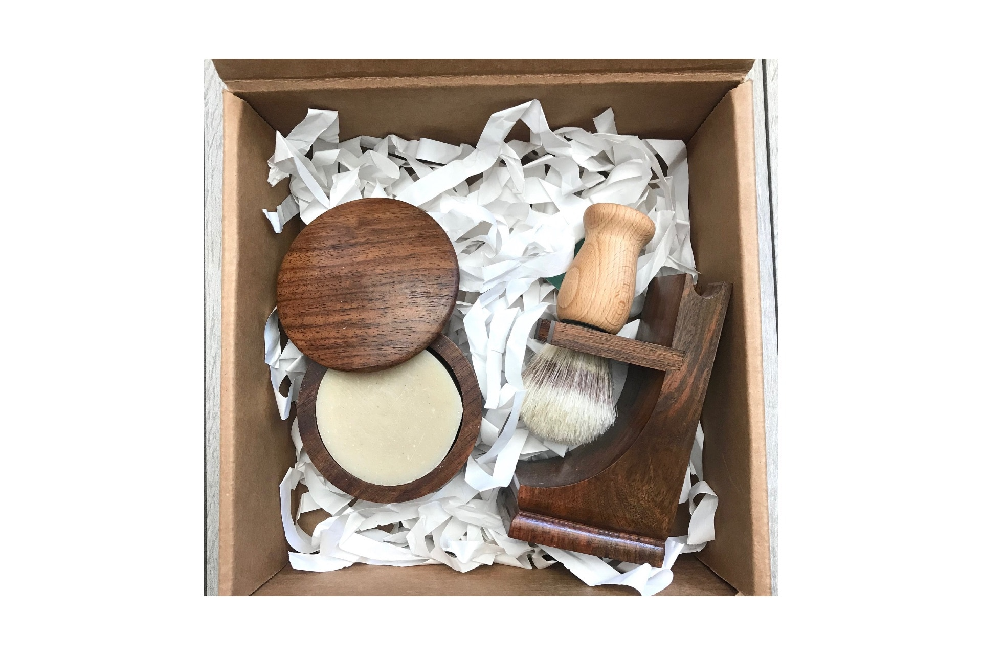 box with wooden face shaving brush and lotion holder