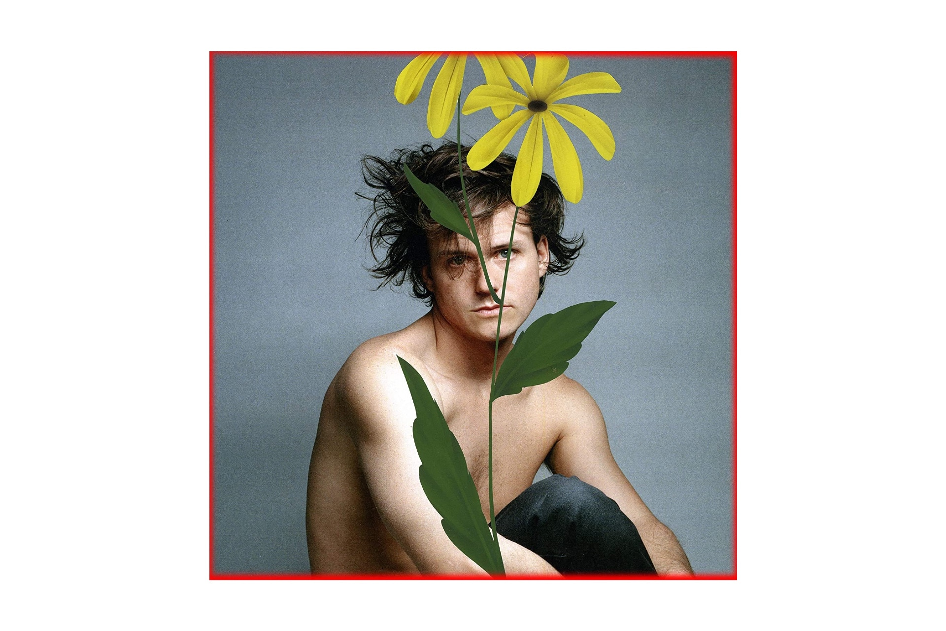 comedy album cover with photo of man and a sunflower