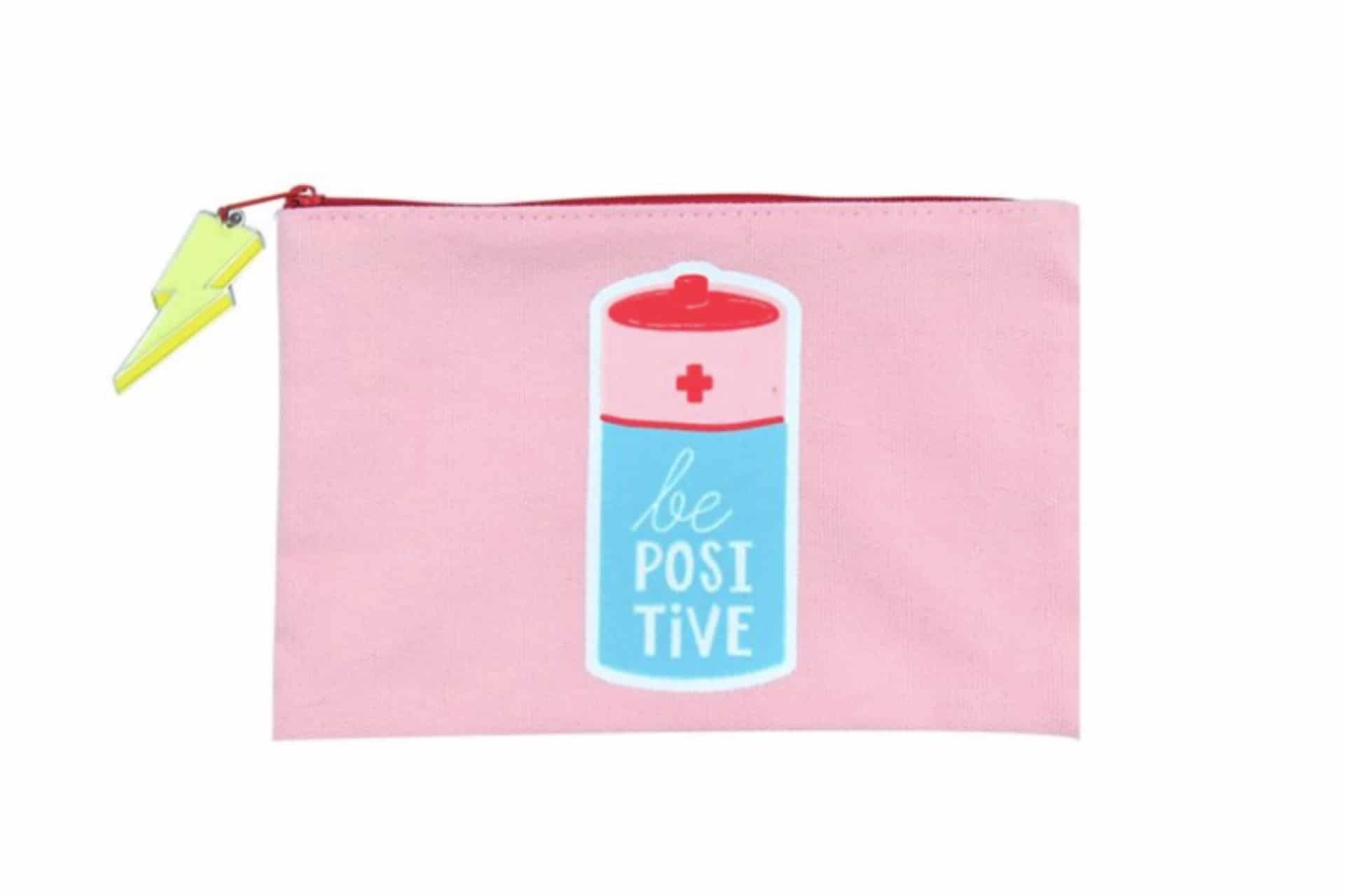 pink pencil case with a battery that says be positive