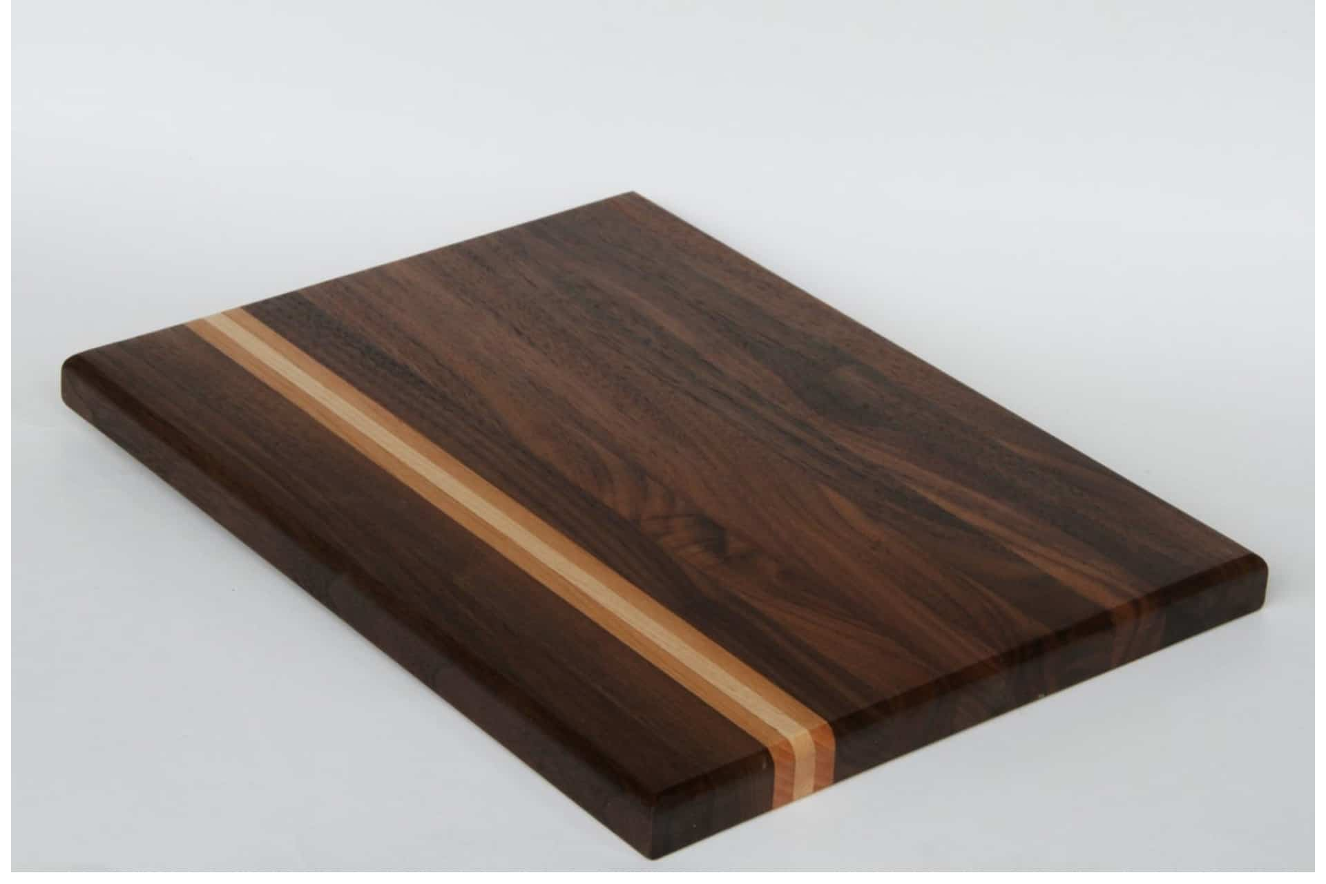 wooden cutting board with a lighter grain stripe through one section