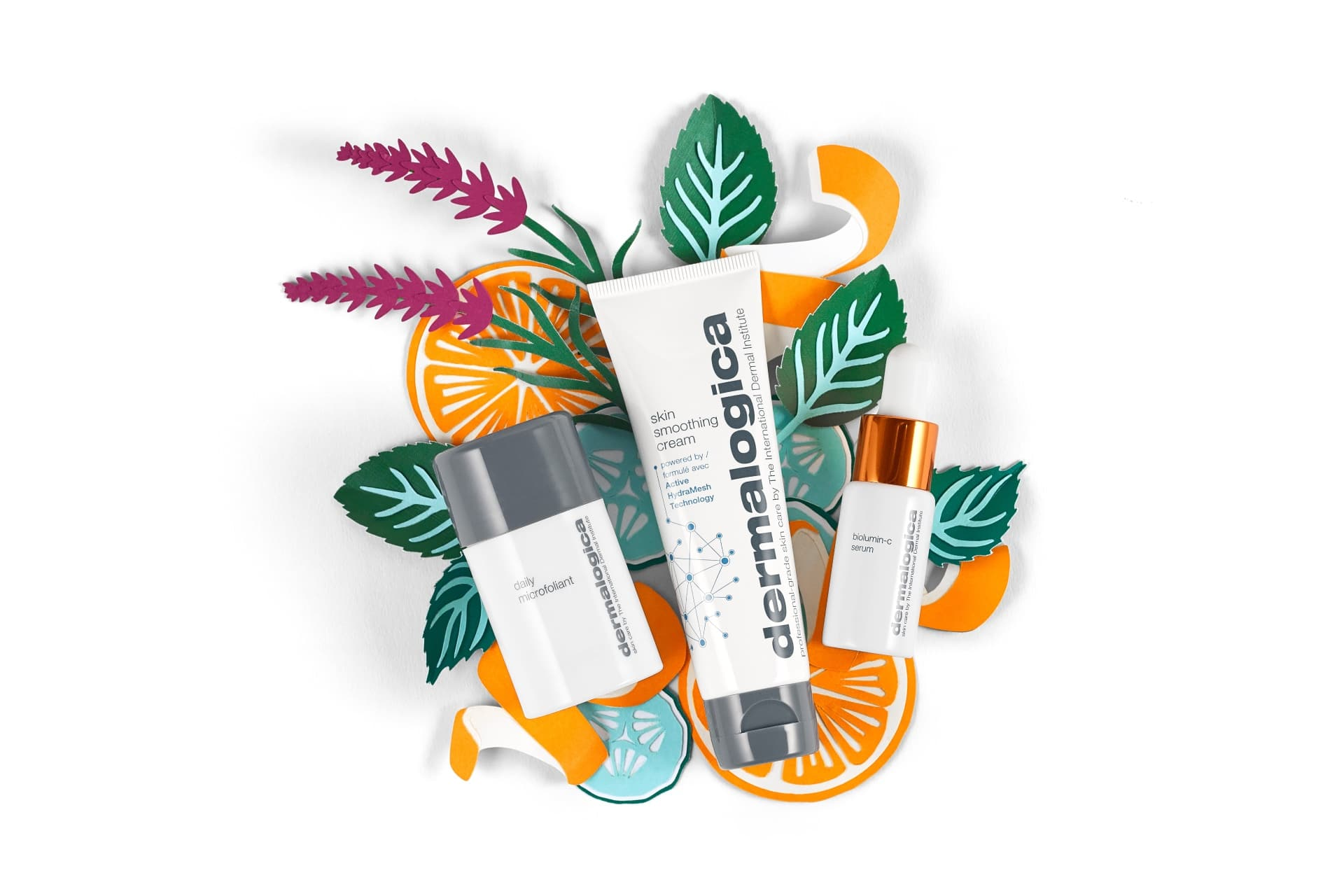 Dermalogica skincare items on a citrus and plant-themed background