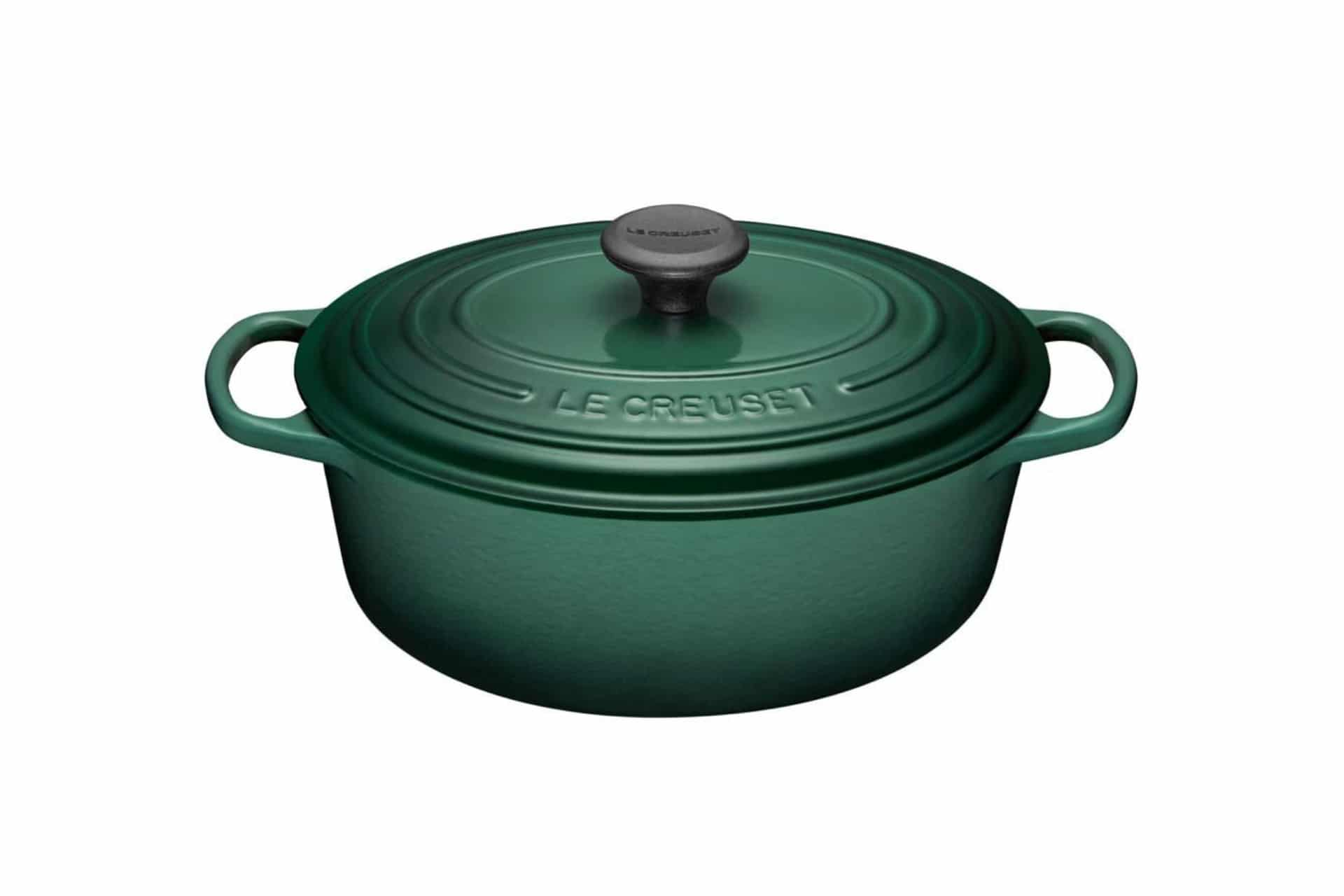 Green Le Creuset French oven on a white background