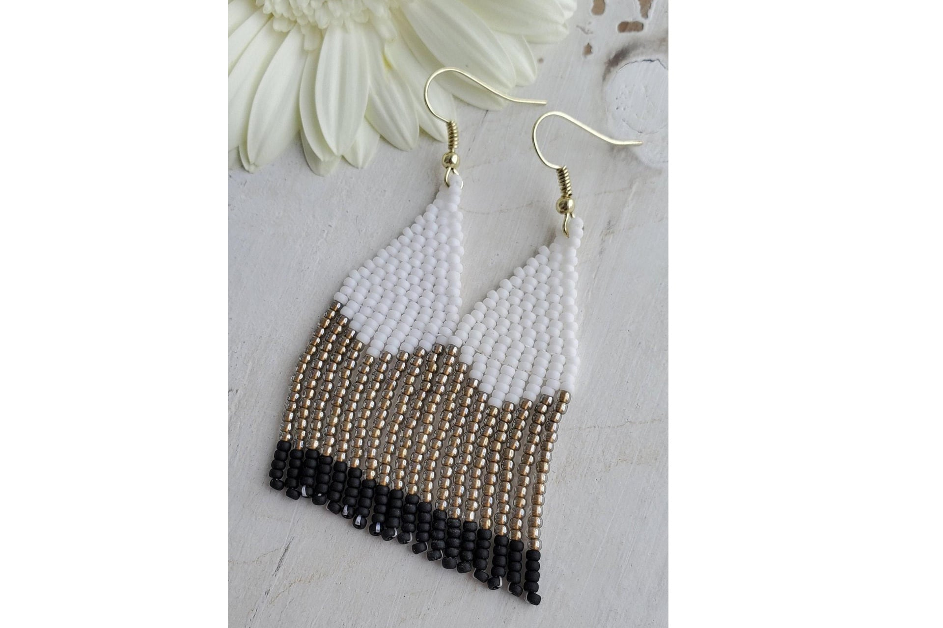 beaded dangly earrings on a white background