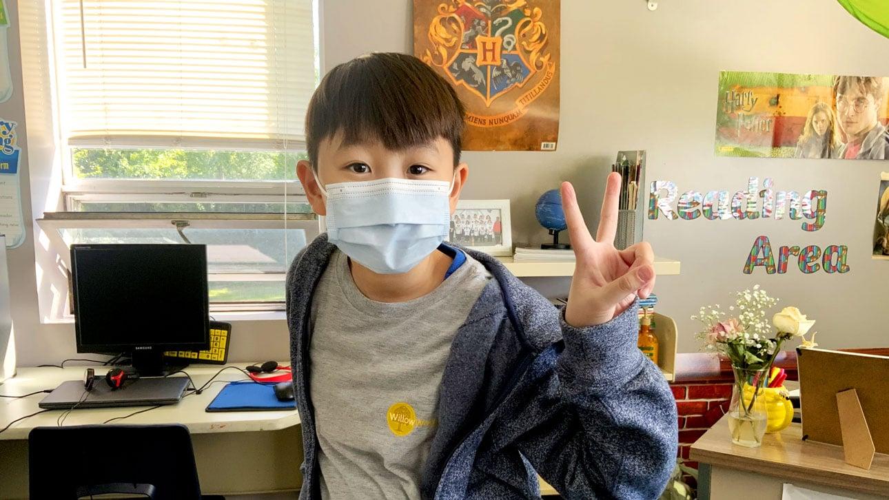 boy wearing mask at school