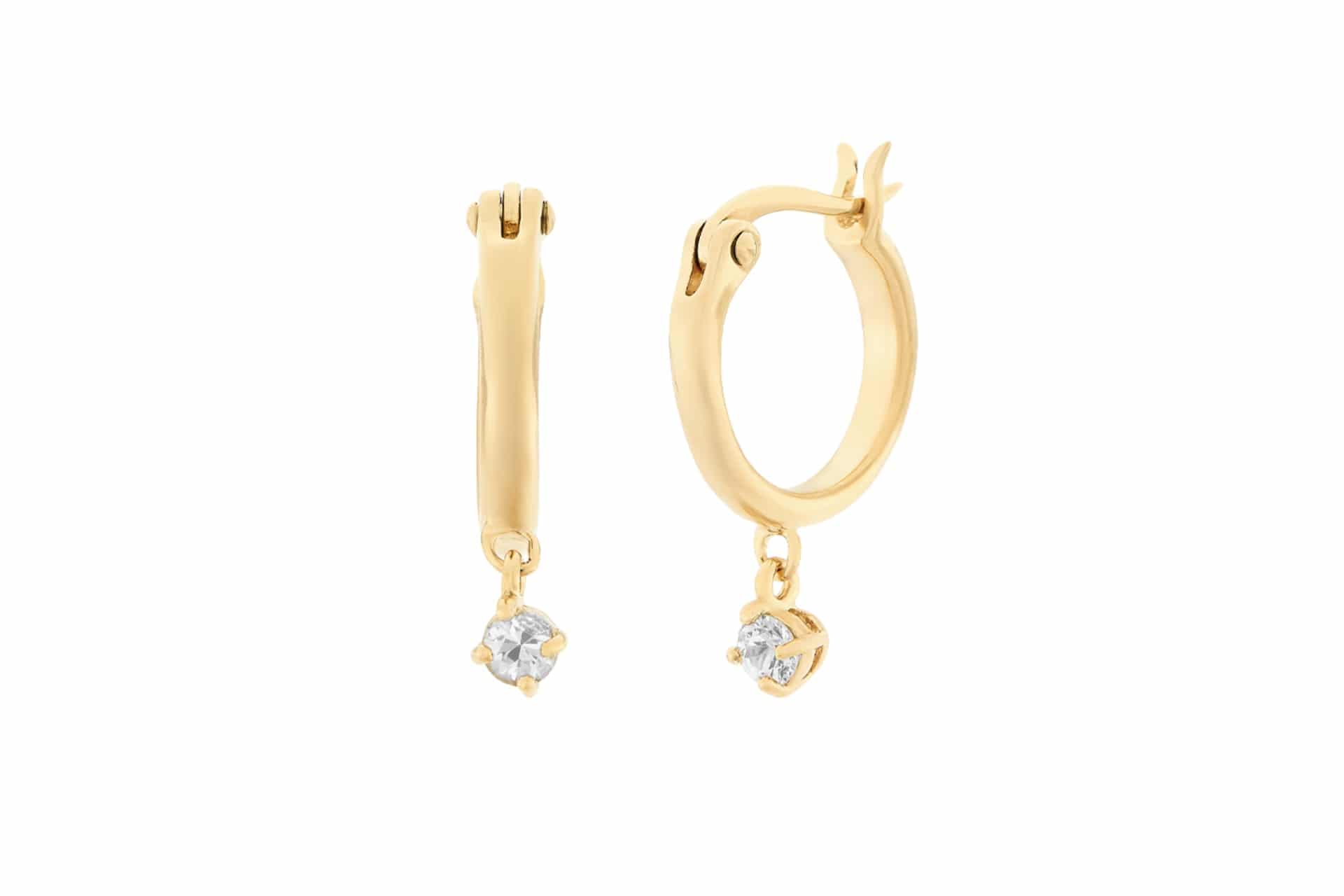 gold hoop earrings with little sapphire sparkles hanging from them