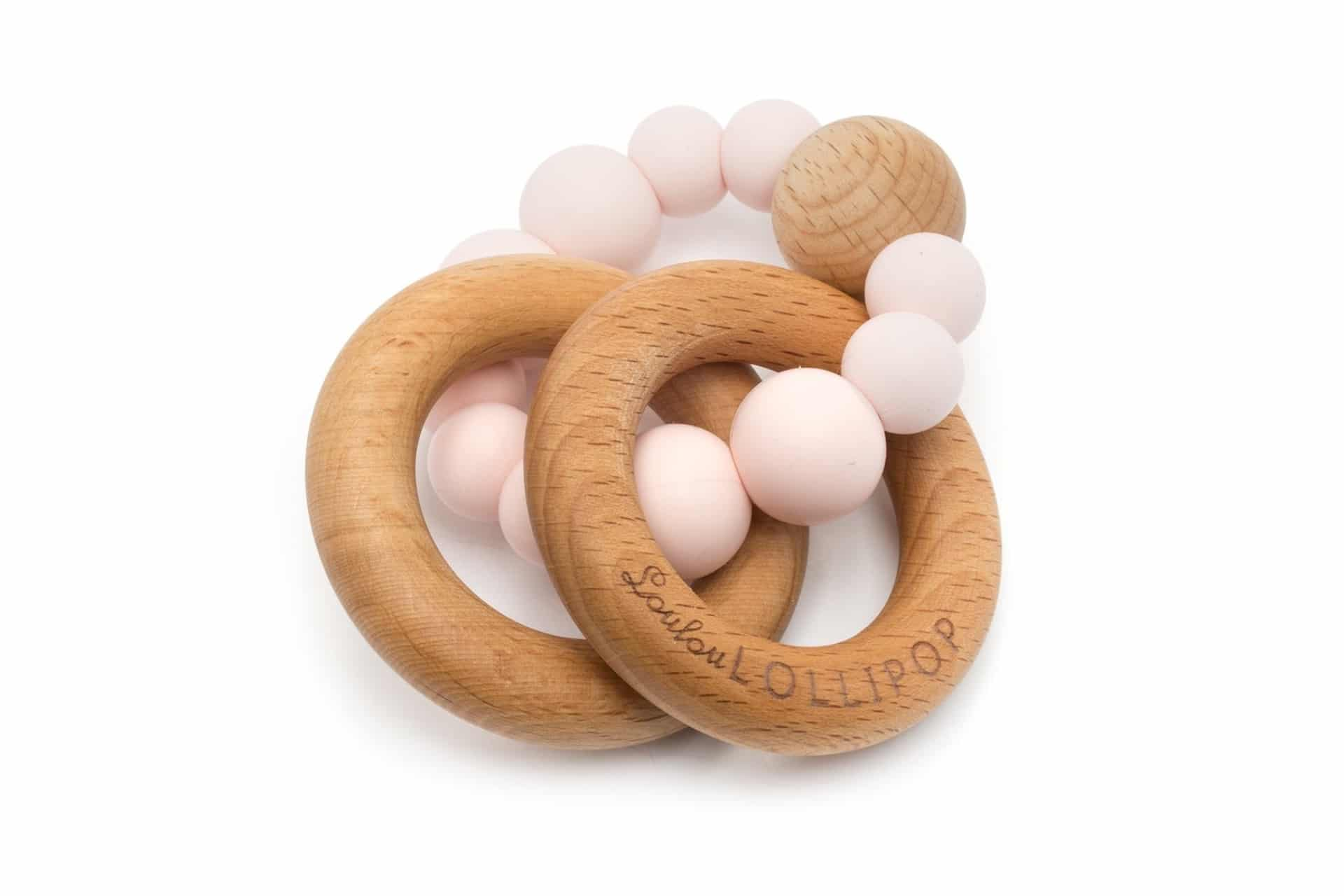 Bubble Silicone And Wood Teether in pinks and natural wood