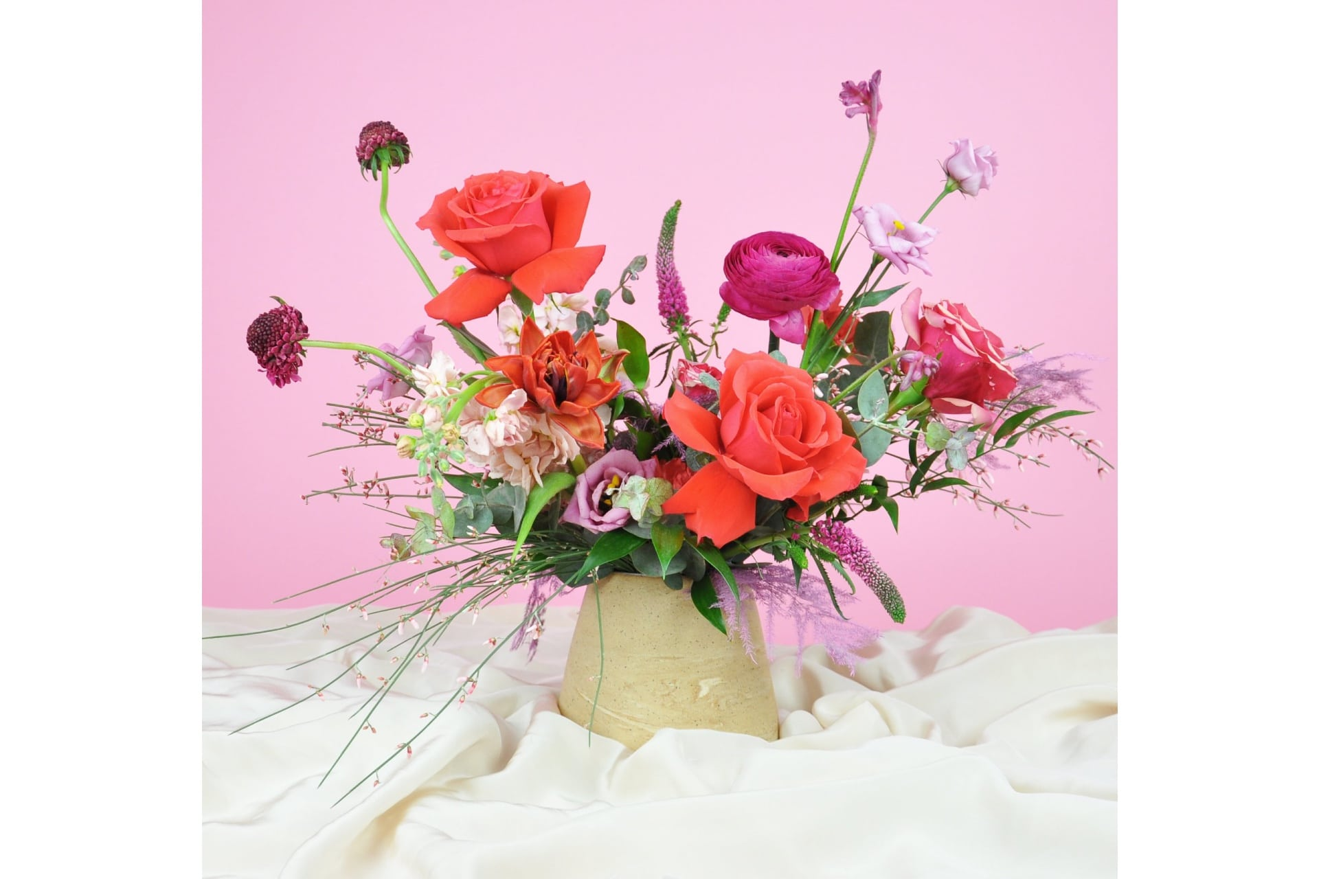 beautiful floral arrangement on a pink background