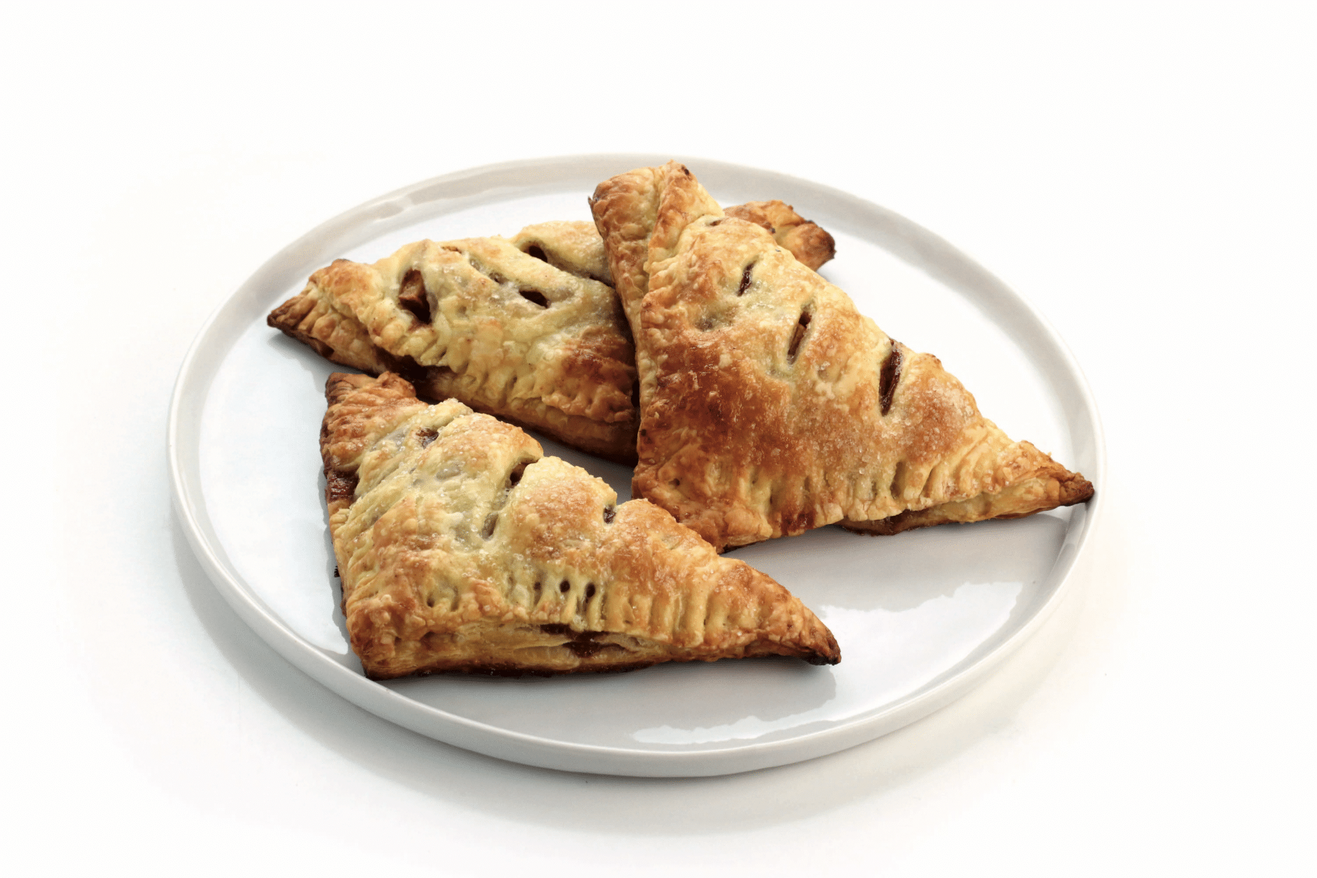 plate of apple turnovers on white background