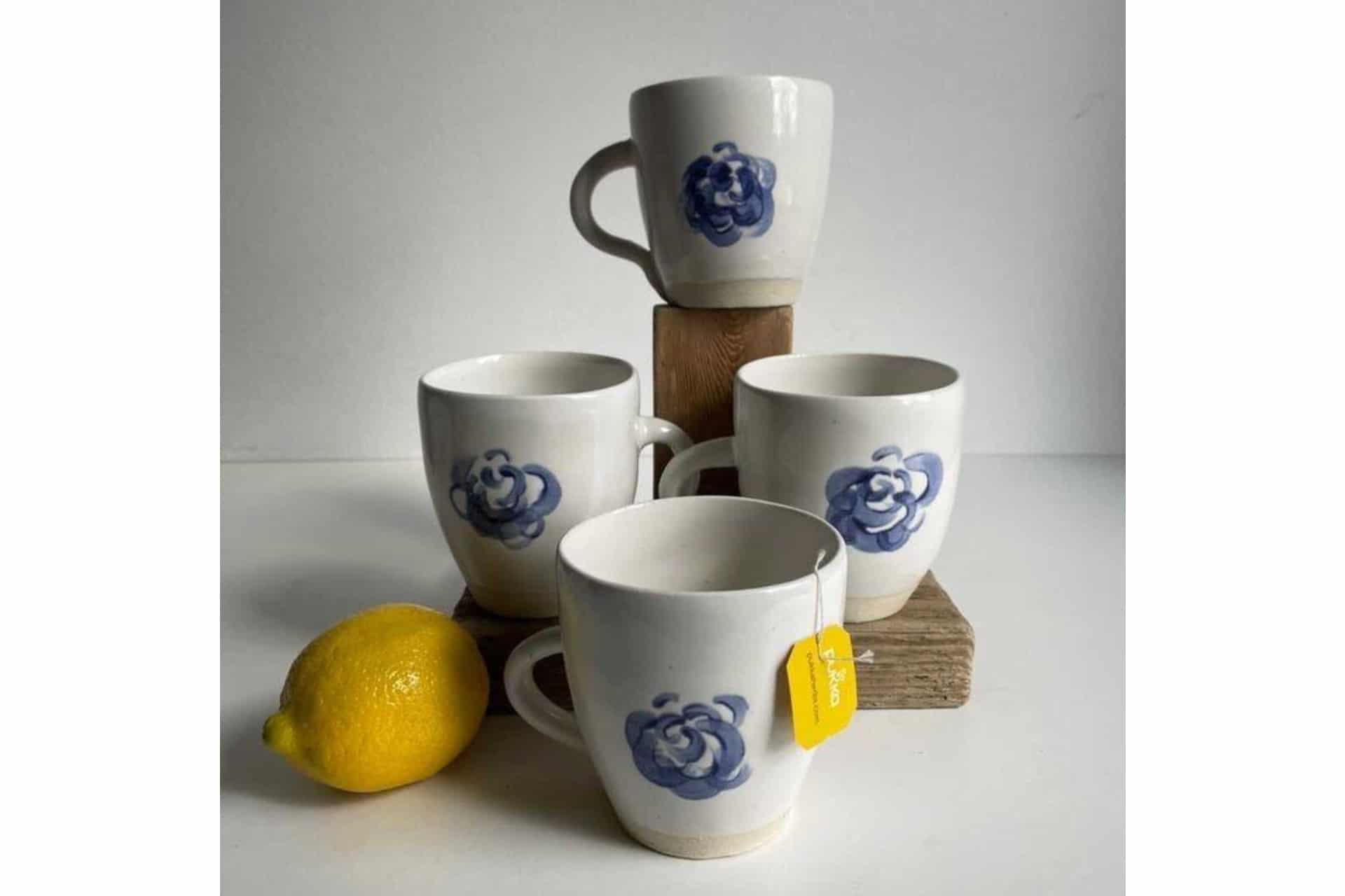 ceramic mugs with blue painted flower
