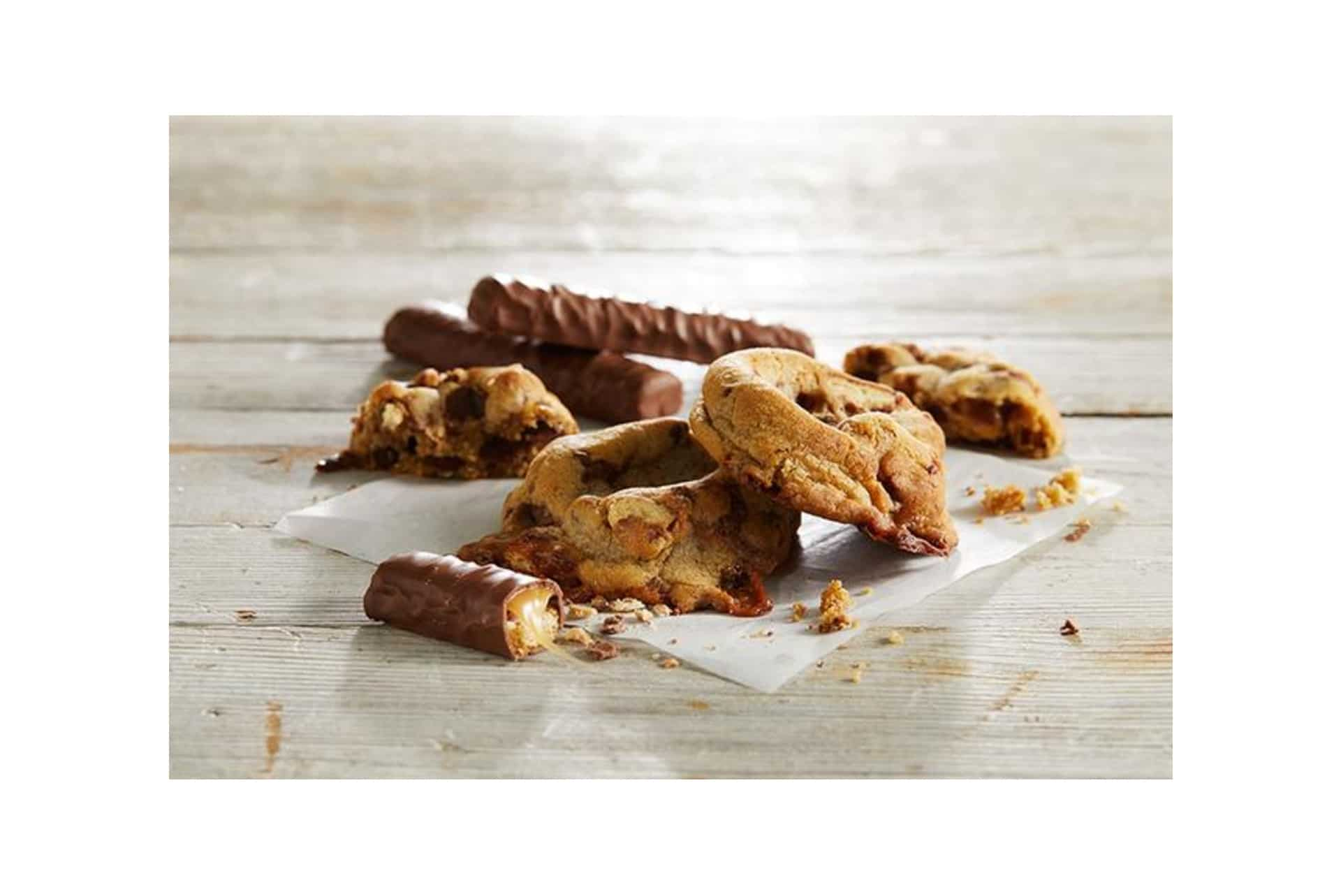 pile of homemade cookies with Twix bars
