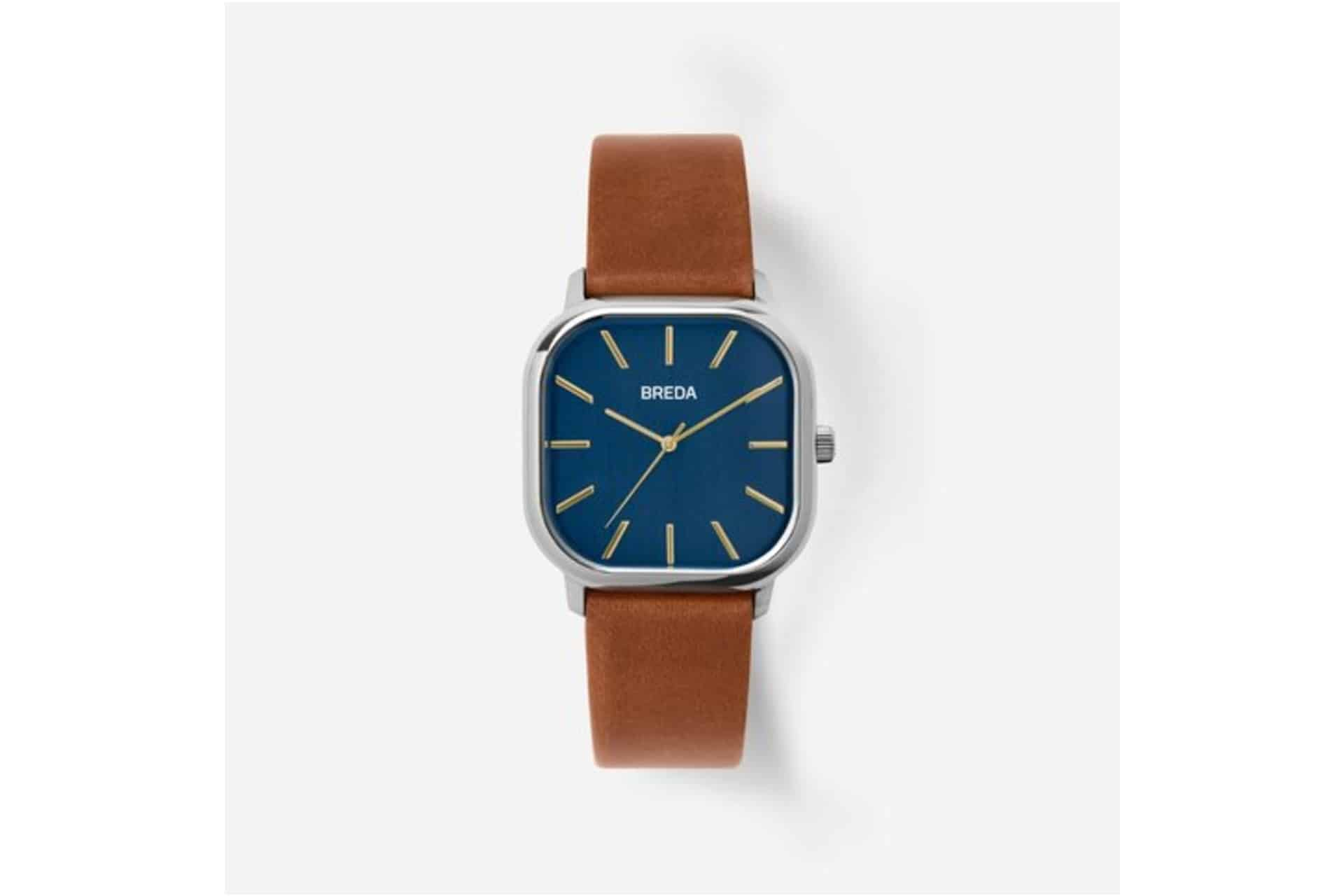 watch with a brown leather strap