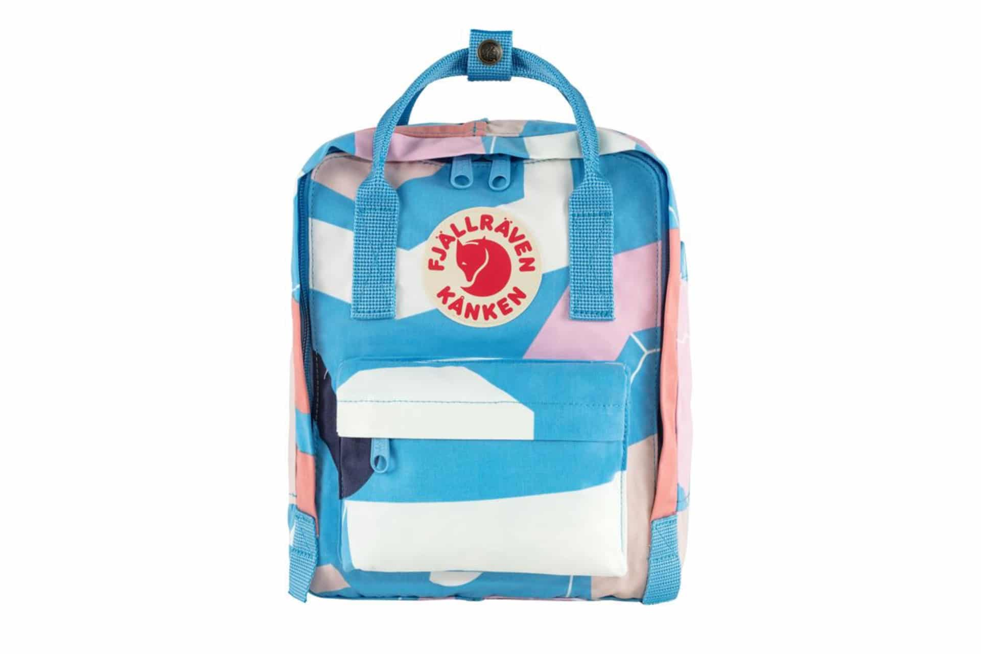 small colourful backpack with patches of pinks and blues